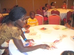 Cousin Margaret Billingsley assists the kids with their coloring activities.