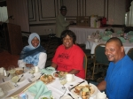 Cousin Leticia Love and family sits for a brief moment to enjoy a meal.
