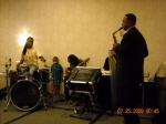 Jerome Smith performing on his saxophone during the family banquet.
