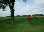 J.C. Beene stands where Obediah Beene's house once stood--the land that we tilled.